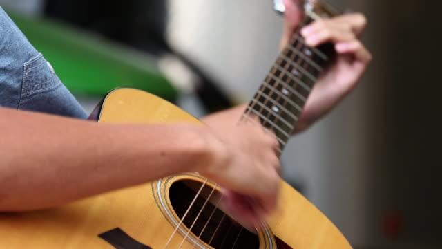 CU R/F Hands of Teenage Boy Playing Acustic Guitar / Richmond, Virginia, United States