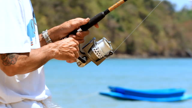 Hands on fishing rod