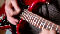 Hands playing electric guitar sequence of three shots