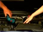 Hands repairing car