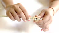 Hands Sharpening a Pencil