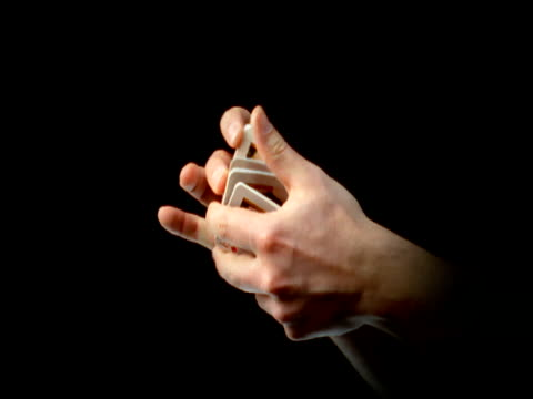 Hands shuffling and holding playing cards