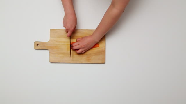 MS Hands slicing Carrot with knife on Cutting Board / Seoul, South Korea