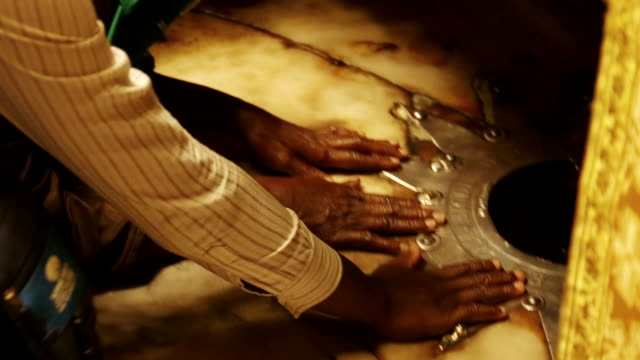 Hands touching the traditional spot believed to be the birthplace of Jesus Christ