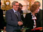 Handshake between Margaret Thatcher Prime Minister and Dr Garret Fitzgerald Irish Prime Minister zoom out to show them holding document files Anglo...
