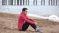 Handsome  man sitting alone at the beach