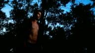 Handsome man walking at dusk