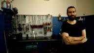 Handsome mechanic in garage