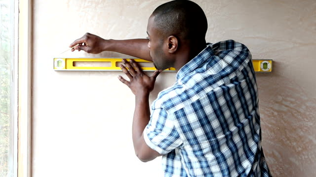 Handyman Using Spirit Level