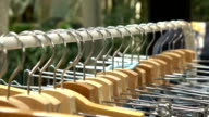 Hangers on the rack at clothing store