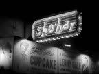 Hanging 'Sho' Bar' neon sign w/ large advertising for 'Cupcake' 'Lenny Gale' wall BG VS Neon signs 'Moulin Rouge' 'Famous Door' Burlesque theatre...