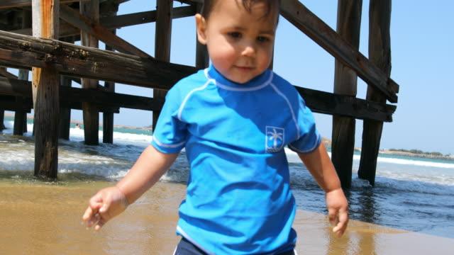 Happy Aboriginal Australian Boy Playing at the Beach