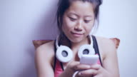 Happy Asian young woman using mobile phone.