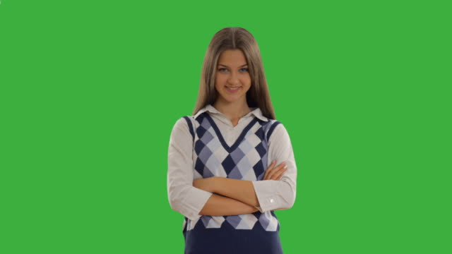 happy beautiful student on the green screen