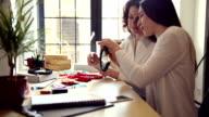Happy beautiful woman designing and making women's jewelry