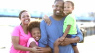 Happy black family with two children outdoors