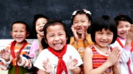 Happy Chinese school children clapping