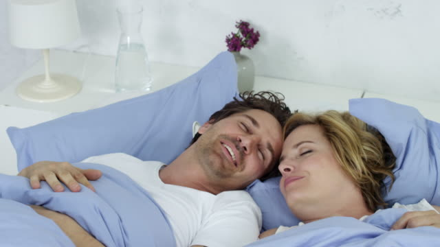 happy couple chilling in bed