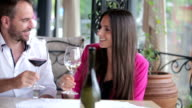 Happy couple drinking white wine in restaurant