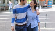 Happy Couple Is Talking While Walking In City
