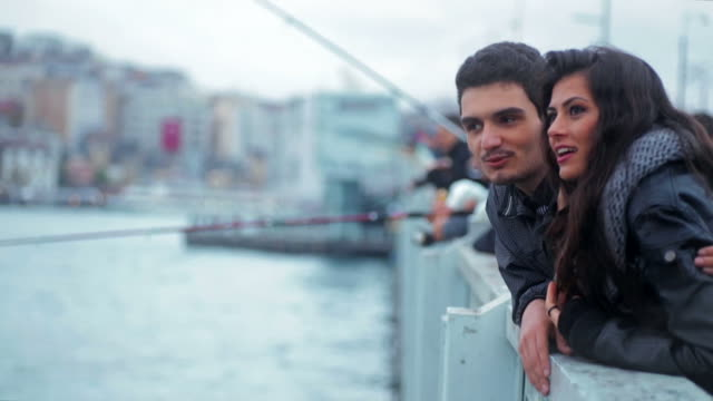 Happy couple on the Galata Bridge in Istanbul