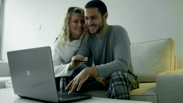 Happy couple purchasing something on internet