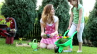 HD: Happy Family Gardening in a Backyard Together.