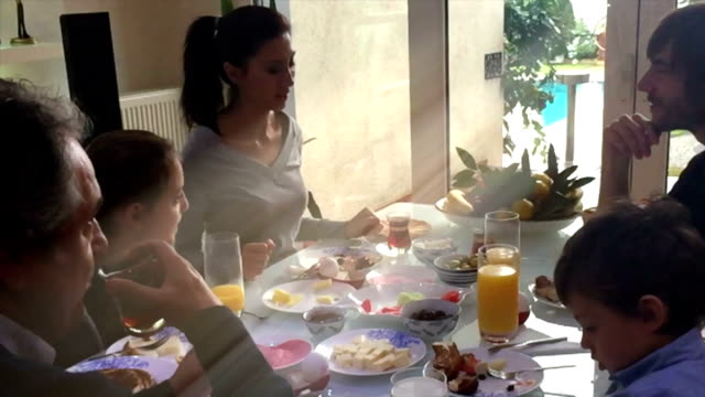 Happy family having breakfast together in hoiday