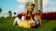 Happy Family in park. Father plays with his daughter