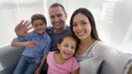 Happy family taking a selfie video
