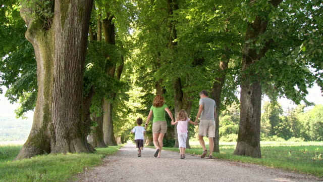 HD DOLLY: Happy Family Walking In The Park