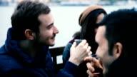 Happy friends drinking hot tea in Istanbul, Turkey