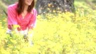 Happy girl in yellow flower field