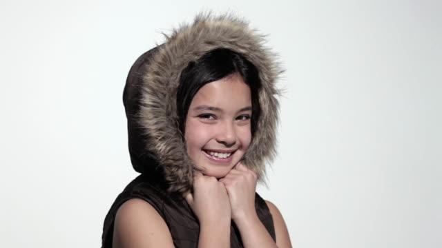Happy girl wearing a furry hood
