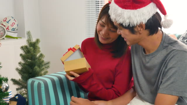 Happy husband giving present to his wife