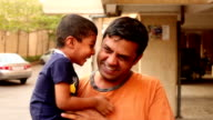 Happy Indian child playing with his father