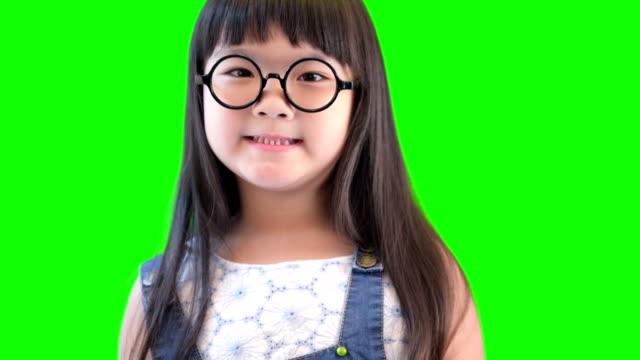 happy joyful beautiful little girl on green background