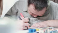Happy man with Down syndrome coloring