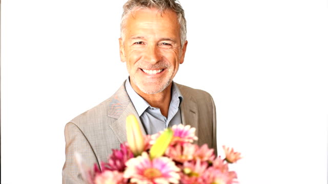Happy mature man giving bouquet
