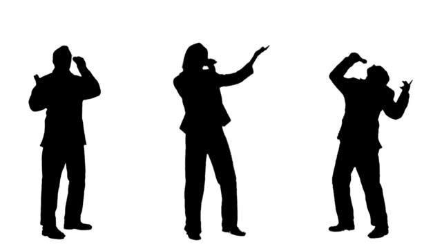 Glückliche Menschen singen Silhouetten