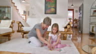 HD: Happy Playful Little Girl With Grandmother