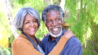 Happy senior African American couple embracing and talking