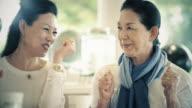 Happy Senior Ladies in Cafe