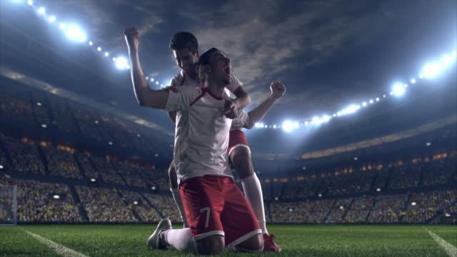 Glada fotbollspelare