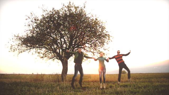 Happy three friends jumping