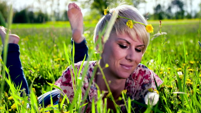 HD DOLLY: Happy Woman Blowing Dandelion
