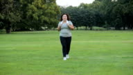 Happy woman jogging in a park