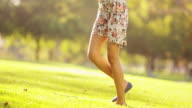 Happy woman standing on grass