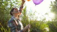 Happy woman with party balloons.
