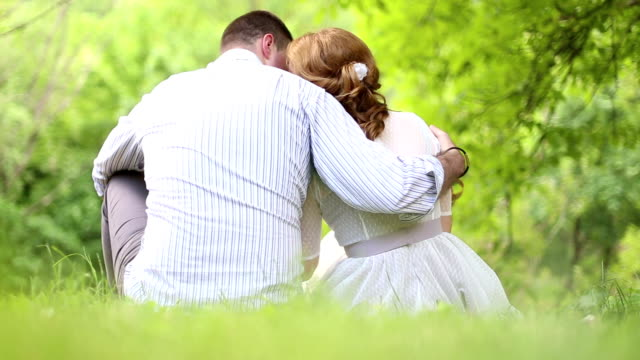 Happy young Couple hugging and laughing by the river